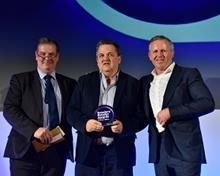 David Campbell collecting the Retailers Retailer of the Year award